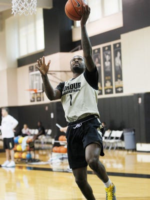 Graduate transfer Johnny Hill during a layup drill at men's basketball practice Monday, October 5, 2015, at Cardinal Court on the campus of Purdue University.