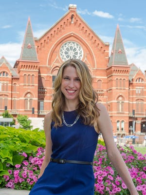 """Cincinnati author Jessica Strawser, whose debut novel """"Almost Missed You"""" is set here, is pictured in front of Music Hall in Over-the-Rhine."""