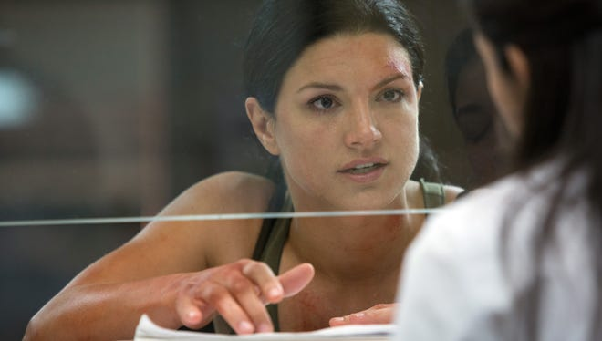 """Gina Carano stars as a woman desperately trying to find her husband in a foreign country in the action drama """"In the Blood."""""""