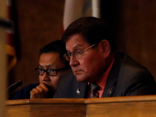Navajo Nation Council Speaker LoRenzo Bates listens on Monday as President Russell Begaye gives his State of the Nation address at the Council Chambers in Window Rock, Ariz.