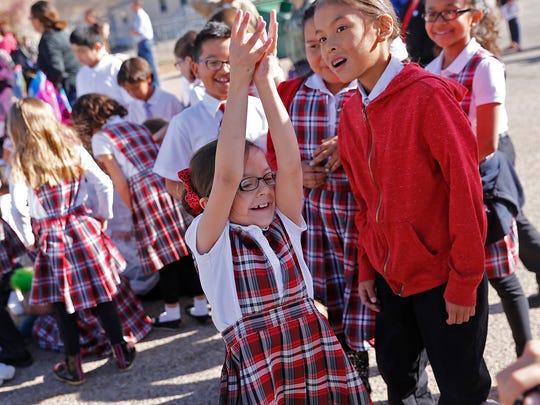 First-grader Isabella Burnham celebrates April 1 during an egg drop event at Sacred Heart Catholic School in Farmington.