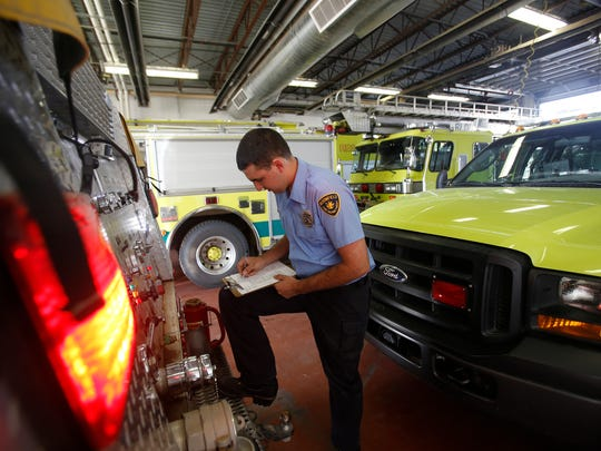 Bloomfield firefighter Tony Herrera checks on a fire engine on March 4 at the station in Bloomfield.