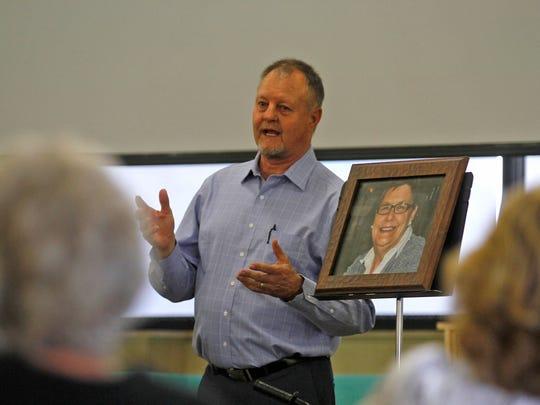 "Pastor Mark Maule presides over a memorial service Friday for Irma ""Jean"" Crawford at the Mountain Vista Baptist Church in Farmington."