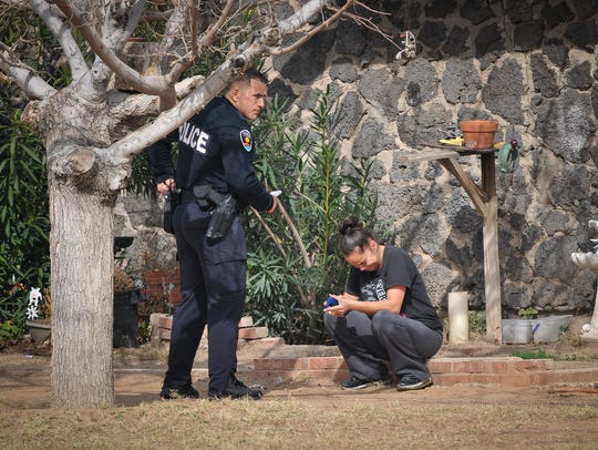 A Las Cruces police officer talks to a woman Feb. 14