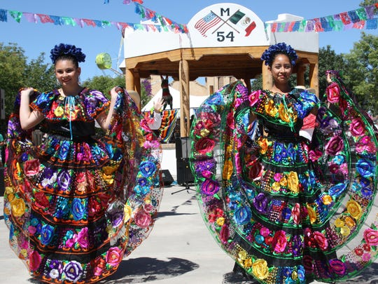 Dancers posed to display their fancy dresses at the