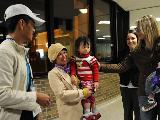 The Wai Hinn family receives a warm welcome from World