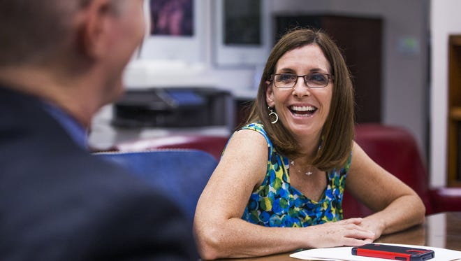 Rep. Martha McSally, R-Ariz, meets with Terry Rozema, police chief of the town of Marana, in her offices in Tucson Aug, 21, 2017.