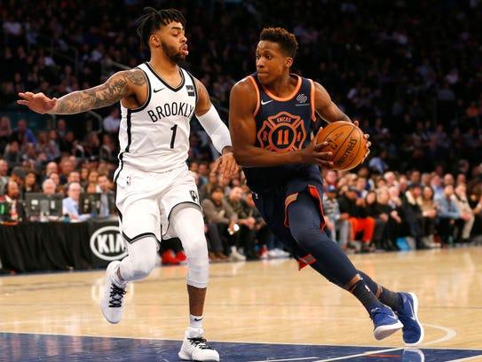 New York Knicks guard Frank Ntilikina (11) drives to