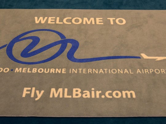"A rug in the meeting room of the Orlando Melbourne International Airport bears a contested name: Orlando airport authorities want the Melbourne airport to drop the ""Orlando,"" saying it causes confusion."