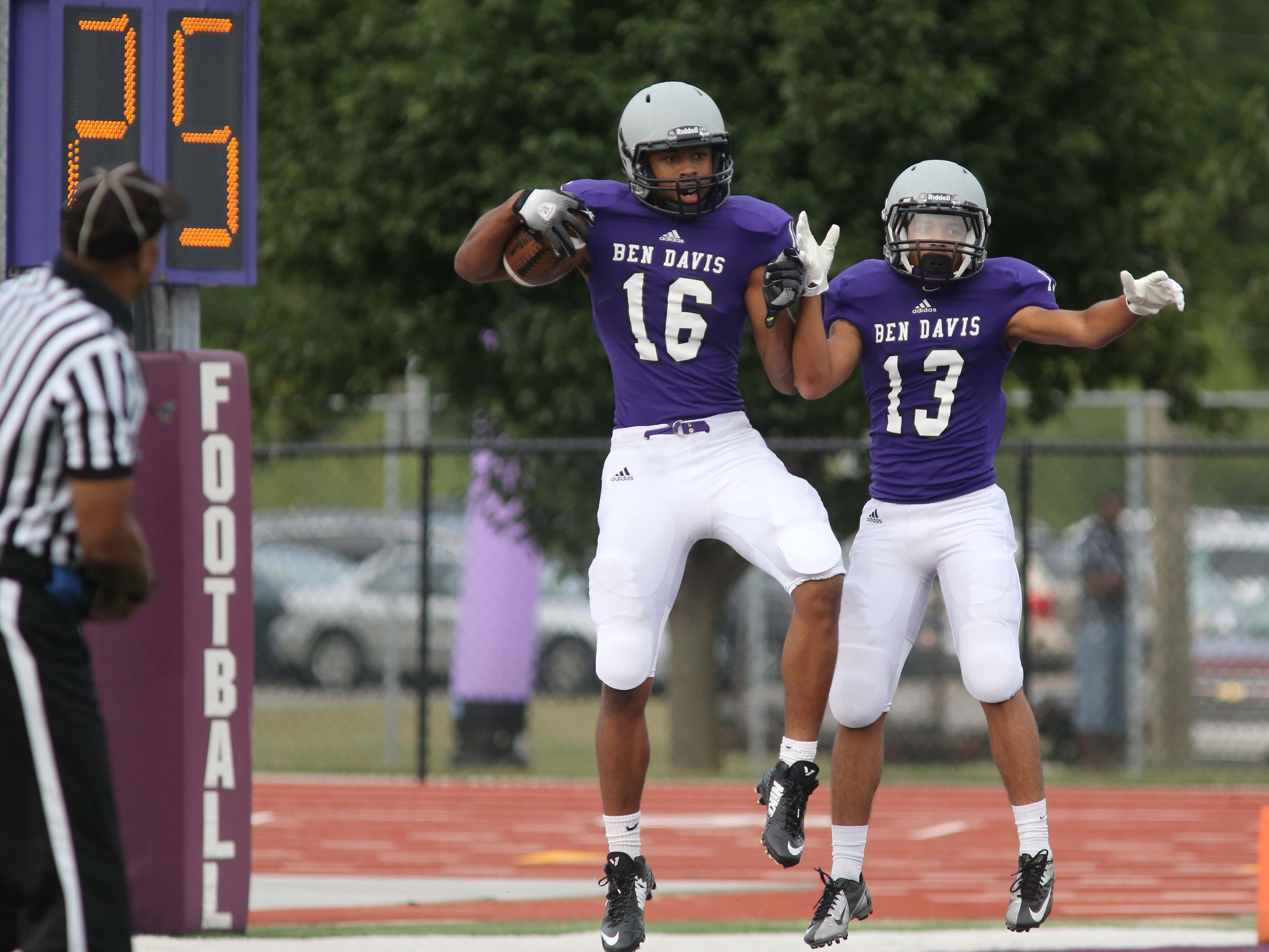 Stori Emerson and Rashawn Bond celebrate an Emerson touchdown reception. Ben Davis hosted Westfield in a football scrimmage Friday August 15, 2014.