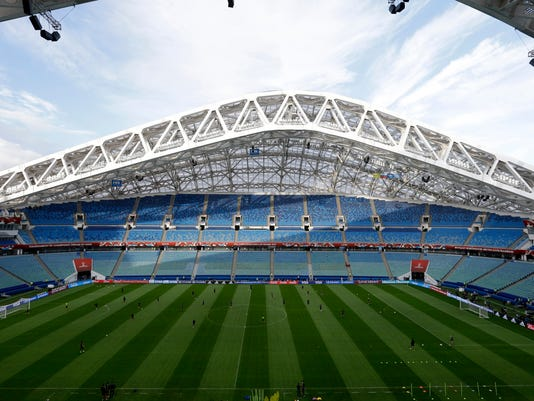 """FILE - In this Tuesday, June 20, 2017 file photo, Mexico players practice during a training session at the Fisht Stadium in Sochi, Russia. The Russian city of Sochi's only professional soccer club says it's withdrawing from the league, in a move which calls World Cup legacy plans into question. FC Sochi says in a website statement that it's """"taking a break"""" to rethink its strategy but plans to return in the 2018-19 season. It didn't mention any deal with Russian football authorities, who would need to approve any return. (AP Photo/Thanassis Stavrakis, File)"""