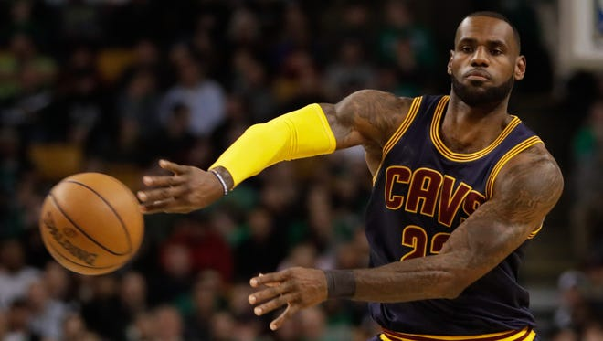 Cleveland Cavaliers forward LeBron James (23) passes against the Boston Celtics in the first quarter at TD Garden.