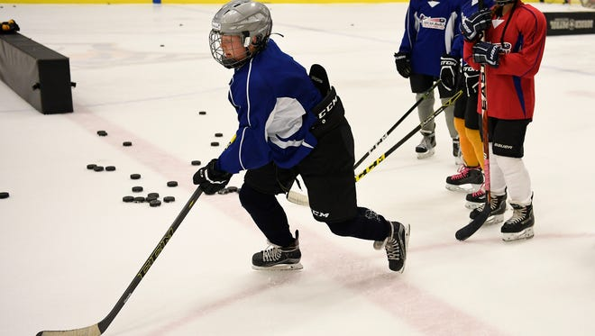 Abbigail Cunkelman practices her hockey skills at the Breakaway hockey camp at Centennial Sportsplex on July 22, 2017, in Nashville.