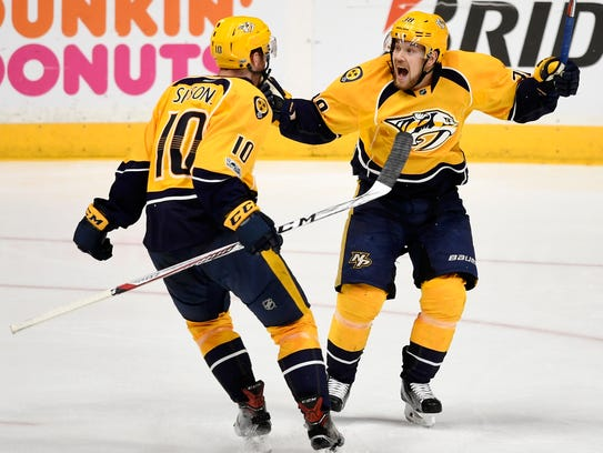 Nashville Predators center Colton Sissons (10) and