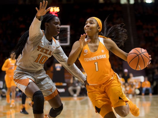 Tennessee guard Anastasia Hayes (1) drives past Texas guard Lashann Higgs (10) during Tennessee's home basketball game against Texas at Thompson-Boling Arena on Sunday, Dec. 10, 2017.