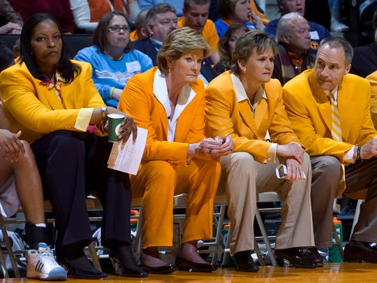Coaches on the Tennessee bench, from left, assistant coach Daedra Charles-Furlow, head coach Pat Summitt, assistant head coach Holly Warlick, and assistant coach Dean Lockwood wore orange blazers in the game against Vanderbilt in March 2009.