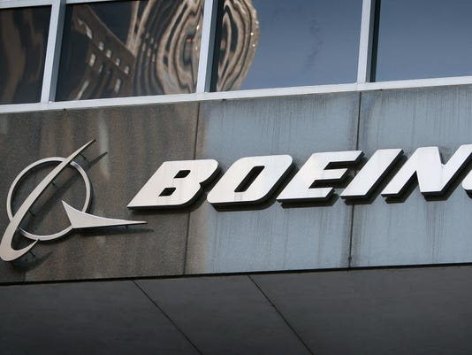 GTY BOEING POSTS 56 MILLION QUARTERLY LOSS, AND ITS CUTTING 10,000 JOBS A EMP USA IL