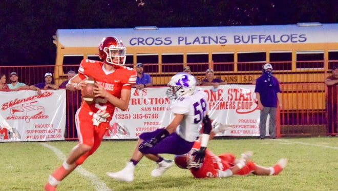 Miles' Hayden Johnson avoids a Cross Plains defender in the Bulldogs 41-12 loss to the Buffaloes.