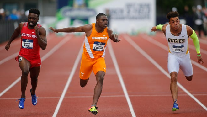 Tennessee's Christian Coleman, center, beats Houston's Cameron Burrell, left, and North Carolina A&T's Christopher Belcher, right, to win the men's 100 meters on the third day of the NCAA outdoor college track and field championships in Eugene, Ore., on Friday, June 9, 2017. Coleman won in 10.04 seconds, Burrell finished second and Belcher third.
