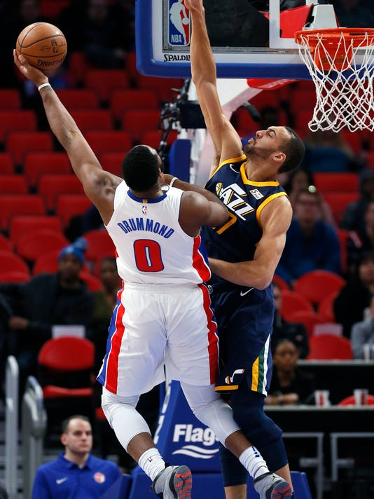 Utah Jazz center Rudy Gobert, right, defends against a shot by Detroit Pistons center Andre Drummond (0) during the first half of an NBA basketball game Wednesday, Jan. 24, 2018, in Detroit. (AP Photo/Duane Burleson)