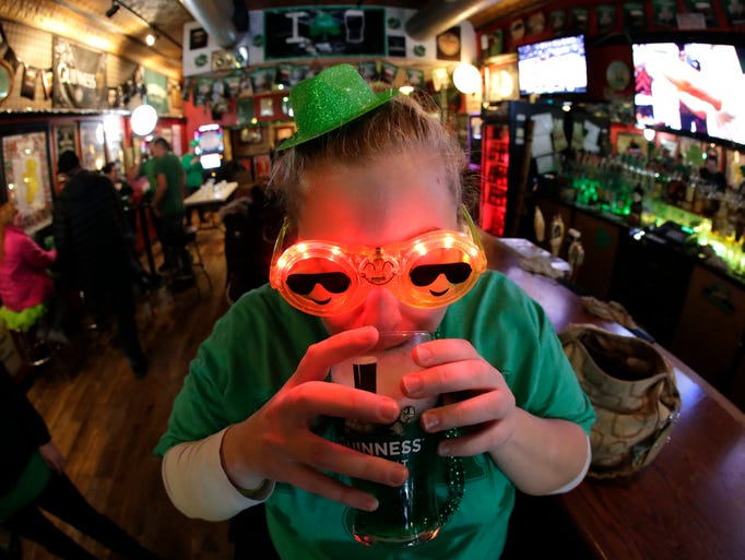 Lindsay Keepers of Appleton enjoys a green beer while