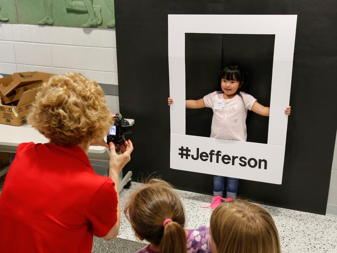 Madelyn Lee, 6, gets her picture taken in the photo