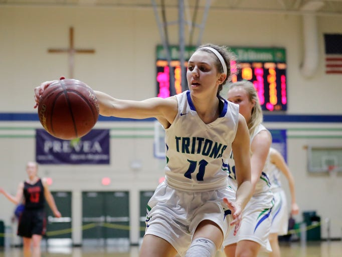 Notre Dame's Emily Johnson (11) grabs a rebound against
