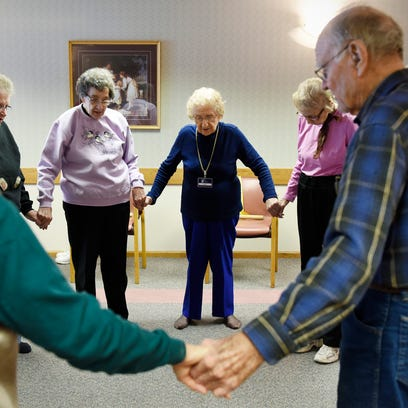 Ida Sass, 100, leads her aerobics class with toe touches, stretching and breathing exercises Friday, Feb. 5, at a Good Shepherd facility in Sauk Rapids.