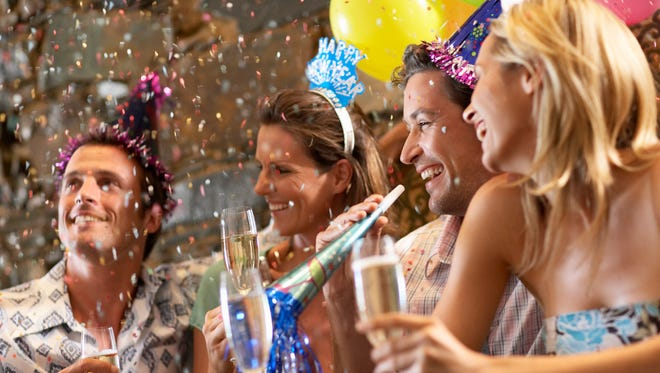 Stock image of couples at New Year's Eve party.