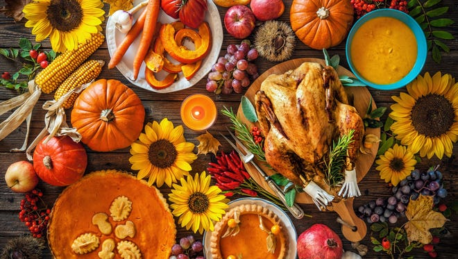 In this file photo, a turkey sits upon a table decked out for Thanksgiving.