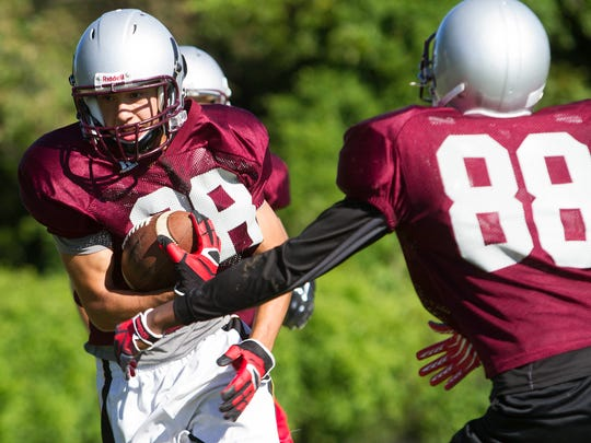 Hodgson running back Anthony Ramirez runs the ball during a drill as Delaware's high school football teams hold their first practices of the season on Friday.
