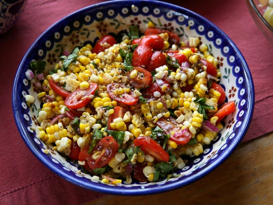Corn, tomato and Basil Salad is dressed with a mustard vinaigrette.