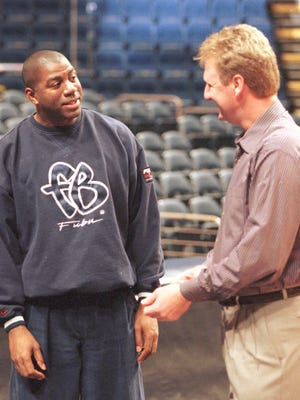 Indiana Pacers coach Larry Bird right jokes with Magic Johnson before the taping of a segment in Indianapolis Monday Feb. 22 1999 on the 20th anniversary of the 1979 NCAA national championship game that featured Bird and Johnson.  The game between Michigan State and Indiana State still has the highest television rating of an NCAA championship game and was won by Johnson and Michigan State. (AP Photo/Michael Conroy)