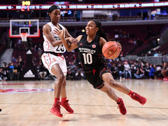 McDonalds High School All-American East guard Anastasia Hayes (10) dribbles the ball West guard Kiana Williams (23) during the first half at the United Center.