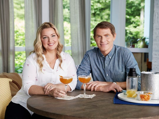 Bobby Flay and Damaris Phillips in the sun room at