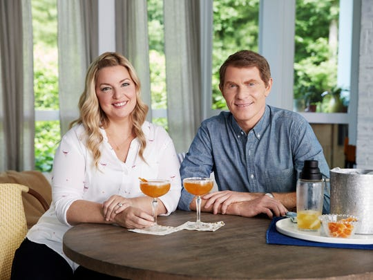 Bobby Flay and Damaris Phillips in the sun room at Bobby Flay's Hamptons NY home as seen on