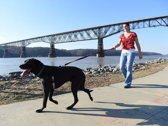Rebecca Borst of Hyde Park walks her dog, Leo at Victor C. Waryas Park in the City of Poughkeepsie on Wednesday.