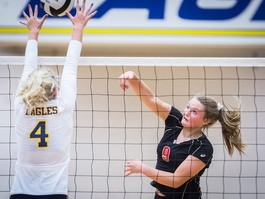 Wapahani's Mallory Summers hits past Delta's defense during a game at Delta High School on Tuesday, Aug. 14, 2018.