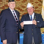 Larry Bishop (left), commander of the Middlesex County American Legion, presents a check to State Commander Mike Babli in support of his four-phased state project to aid homeless veterans at Veterans Haven North and South, and the families of those being interred at the BG William C. Doyle Cemetery, Arneytown.