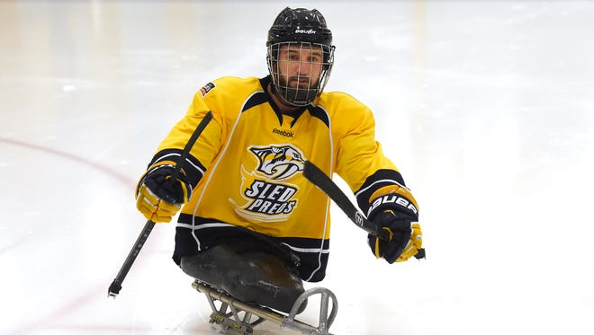 Marine veteran Joey Woodke practices Wednesday at Ford Ice Center in Nashville. Woodke is part of the Sled Preds team.