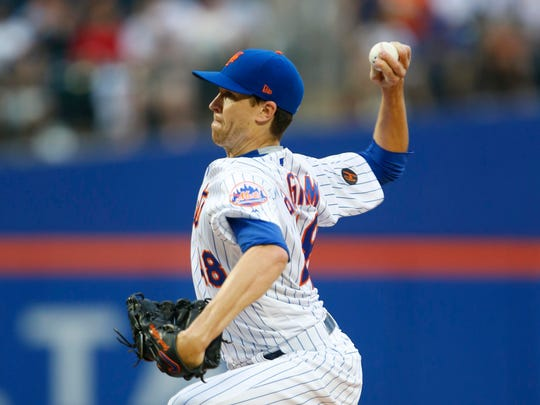 Jun 2, 2018; New York City, NY, USA;  New York Mets starting pitcher Jacob deGrom (48) delivers a pitch against the Chicago Cubs in the first inning at Citi Field. Mandatory Credit: