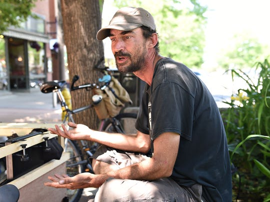 Jimmy, who declined to give his last name, panhandles on College Avenue on June 20, 2016.