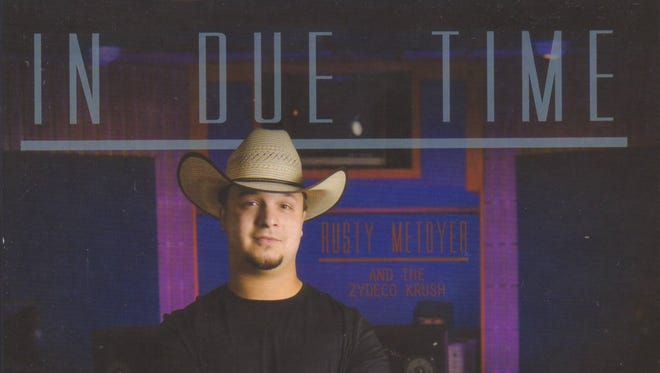 """Rusty Metoyer is shown on the cover of his sophomore CD, """"In Due Time."""""""