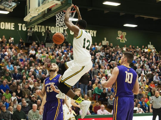 Catamounts forward Darren Payen (12) dunks the ball during the men's basketball game between the Albany Great Danes and the Vermont Catamounts at Patrick Gym last month.