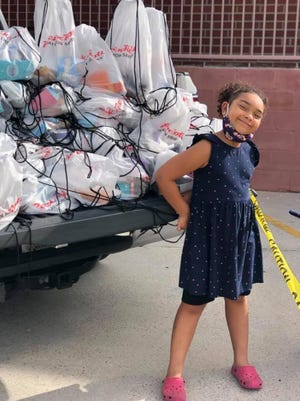 """Bethan Moultry, 6, brought 300 """"Happy Bags"""" to the Union Mission on Wednesday."""