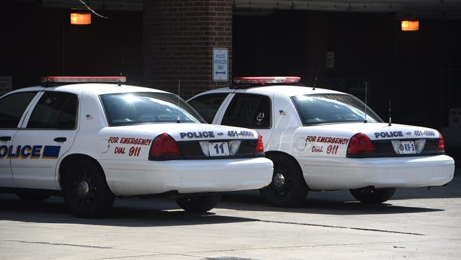 A pair of police cruisers outside Poughkeepsie city Police Headquarters.
