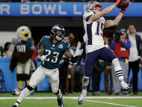 New England Patriots' Chris Hogan catches a touchdown pass during the second half of the NFL Super Bowl 52 football game against the Philadelphia Eagles Sunday, Feb. 4, 2018, in Minneapolis. (AP Photo/Mark Humphrey)