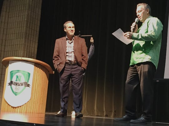 Novi athletic director Brian Gordon (right) introduces