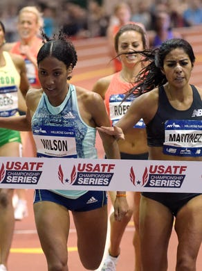 Ajee Wilson (left) defeats Brenda Martinez to win the women's 800 at the Millrose Games in February.