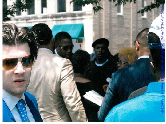 This photo was included among the exhibits released during the American Civil Liberties Union lawsuit against the city of Memphis. The ACLU says it was taken by a plainclothes police officer during a protest outside The Commercial Appeal's Union Avenue building July 13, 2016. It was entered into court records. After online publication of the photo, the man in the blue suit and sunglasses identified himself. He's Aaron Neglia, an activist and lawyer with the firm Horne & Wells. He said he came to the event that day to support the family of Darrius Stewart, a teenager killed by a Memphis police officer. During the protest that day, the Stewart family and lawyers announced a lawsuit against the city.